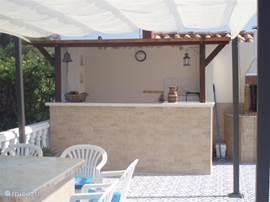 De huisbar aan het terras