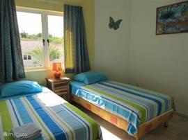 Slaapkamer 3 heeft ook uitstekende bedden.En voor s'nacht de koelte van airco.