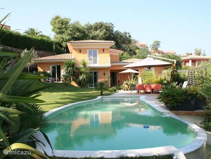 View villa with pool, terrace and garden.