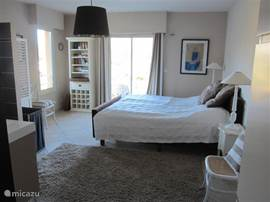 One of two spacious bedrooms with balcony on the 1st floor. overlooking large garden with pool.