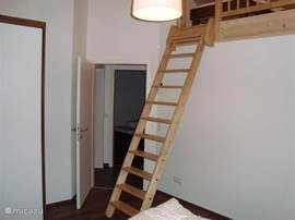 4 person bedroom with balcony facing south. 2 beds on the mezzanine level and 2 bedrooms.