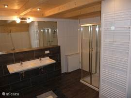Bathroom on upper floor. With double sinks, separate shower, generous bath and toilet.