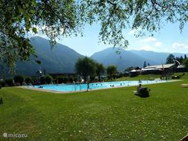 The heated outdoor swimming pool with a beautiful view Kirchbach a beautiful lawn. There is also a restaurant with terrace.