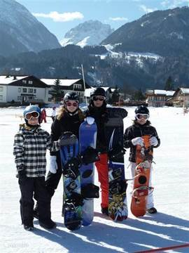 The youthster for the first time on the snowboard!