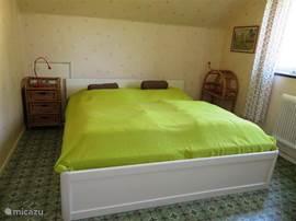 Slaapkamer 3 met een lits-jumeaux bed