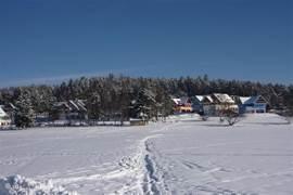 In uw eigen achtertuin kunt u schaatsen, sleeën, langlaufen enz. op het bevroren Lipno meer! Een fantastische ervaring is een sleetocht in een hondenslee getrokken door poolhonden!