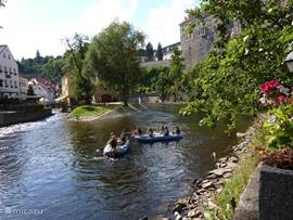 With your canoe or raft through picturesque Krumlov