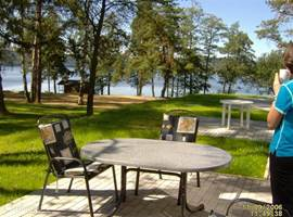 In the summer, sunny, spacious terrace with beautiful lake view.
