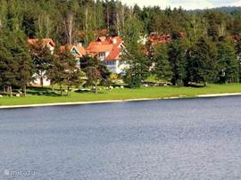 Overlooking the lovely grass and sand beach of Riviera Lipno