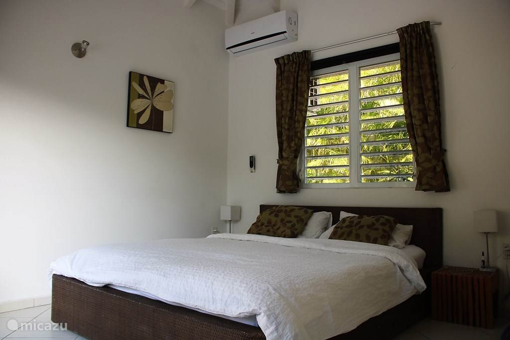 Bedroom 1 is equipped with sliding doors to the terrace