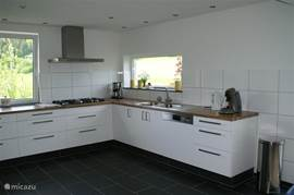 New kitchen with large dining room with fantastic views over the village and the valley