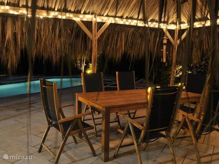 Palapa with dining table and chairs, lovely to sit both daytime and evening hours.