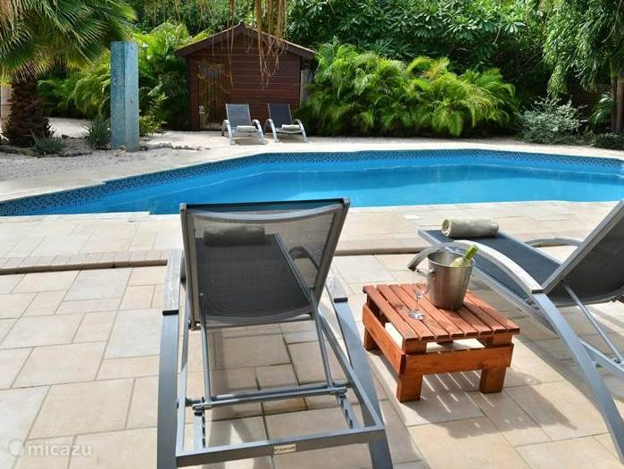 Enjoy a drink on your lounger by the lovely pool.