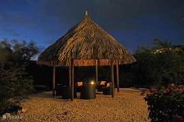 Large palapa in the back garden. Lighting in the palapa, and a candle on the table. Enjoy Curacao watching the sky.