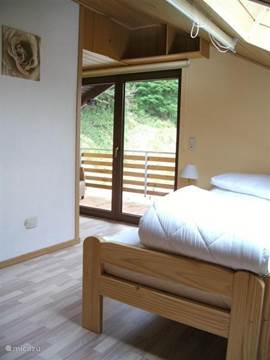 The bedroom in the East has openslaade balcony doors. At the large balcony you can enjoy in the summer of your breakfast.