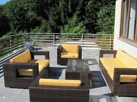 He is almost 50 square mter large roof terrace has a luxury lounge set.