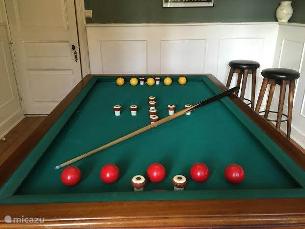 The billiards room with pool tables.