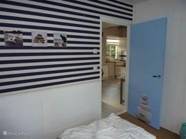 Slaapkamer 2 met 2 boxspring bedden