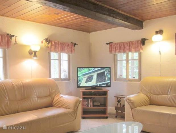 A cozy living room, fully equipped: 3 seater sofas, 2-seater sofa, swivel and reclining chair, 81 cm flat screen satellite TV with built-in DVD player, 230 Books, large extendable dining table.