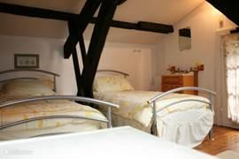 Slaapkamer op de etage.