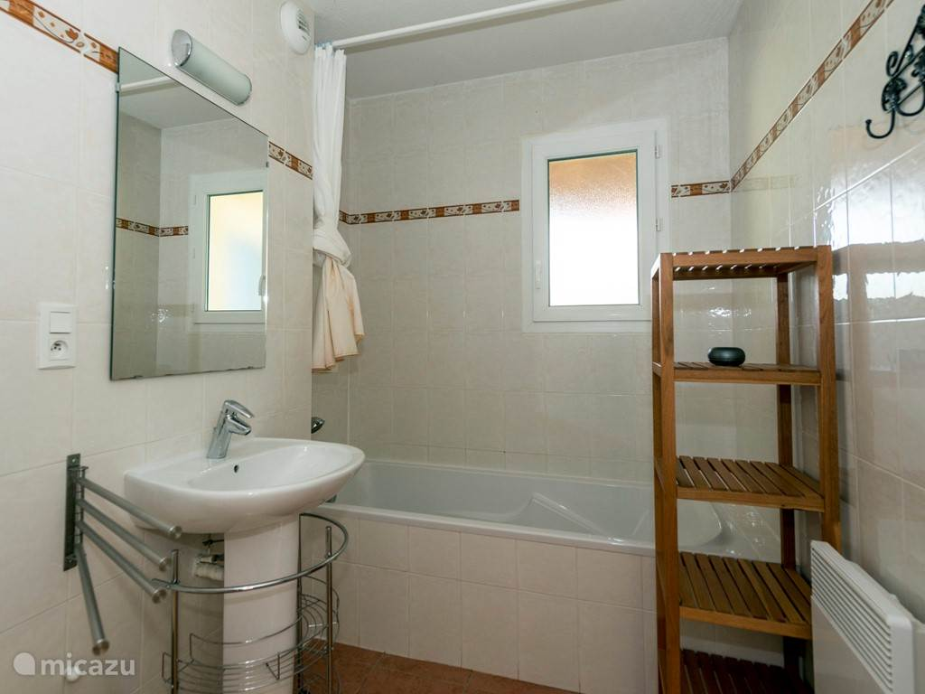 The bathroom (and shower facilities on the ground floor. With sink and toilet. Ample storage space for your toiletries.