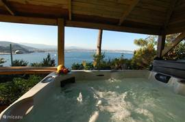 In the garden is a 5 person Jacuzzi with outdoor bar where guests can relax while enjoying a drink