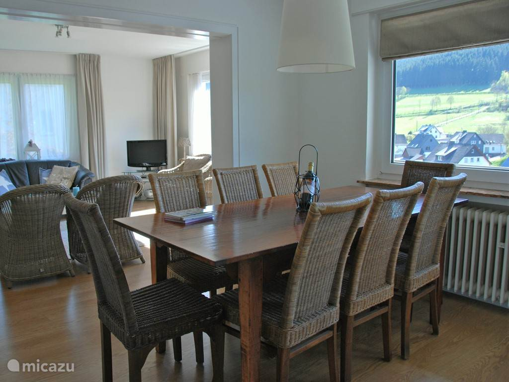 Dining room with a dining table for eight people.