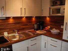 The kitchen (installed in November 2011) is equipped with dishwasher, oven, microwave, fridge and ceramic hob.