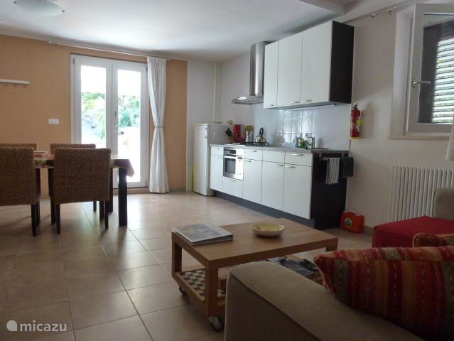 Spacious living room with dining kitchen with microwave oven. The kitchen is fully equipped. Kitchenlinen present. There are patio doors to the terrace and all windows are fitted with fly screens and shutters.