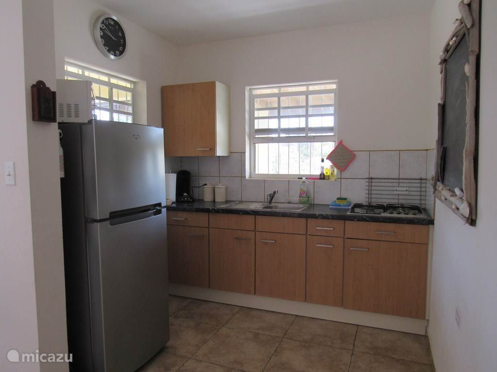 Kitchen with coffee machine, a microwave etc. ..