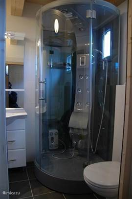 The steam shower with radio in the bathroom downstairs