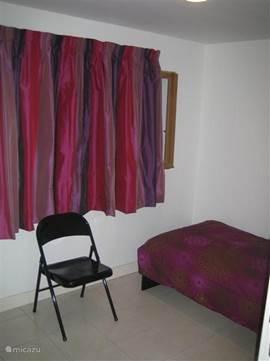 Eenpersoons slaapkamer.