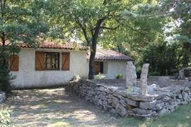 Side view of the rustic cottage.