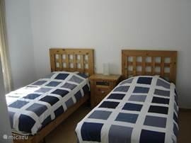 Slaapkamer 3 beschikt over 2 eenpersoons bedden.