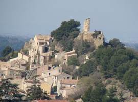 View of the old village with castle ruins. Here is La Ruine.