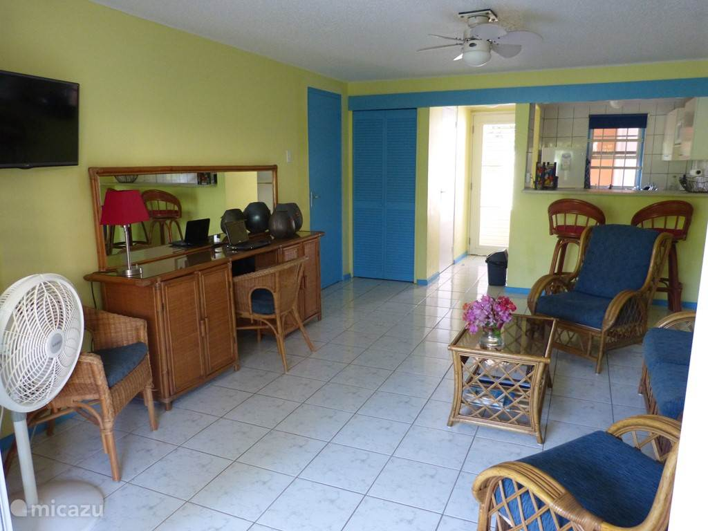 The fresh, bright living room has been recently repainted and decorated in bright tropical colors.
