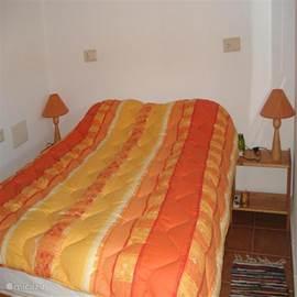 optioneel: Slaapkamer met tweepersoonbed op de tweede etage.
