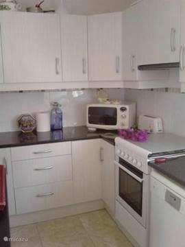 De keuken in appartement Verde voorzien van alle gemakken.