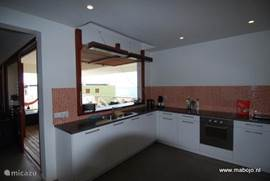 Luxury kitchen with view to terrace and Boca Gentil to sea
