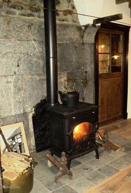 Antique wood stove with the chimney Ardennes is a high efficiency stove, a few blocks of wood fuel you throughout the evening, of course there are other heating available from the beginning of December the house is his Christmas spirit.