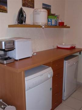 Utility room with tumble dryer, dishwasher, espresso, bread maker, deep fryer and iron. Here is also the stairs to the floor.