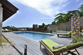 Wooden pool deck and comfortable deckchairs