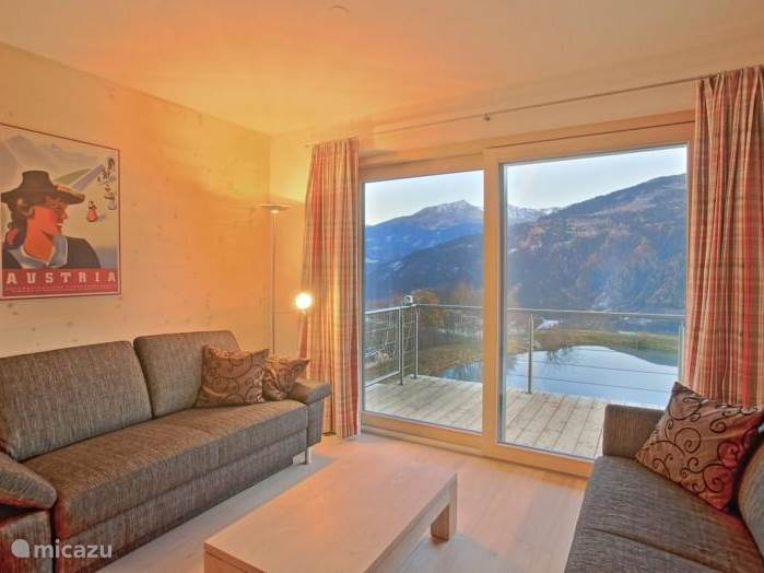 Living room of apartment Kristall with access to large terrace with great views.