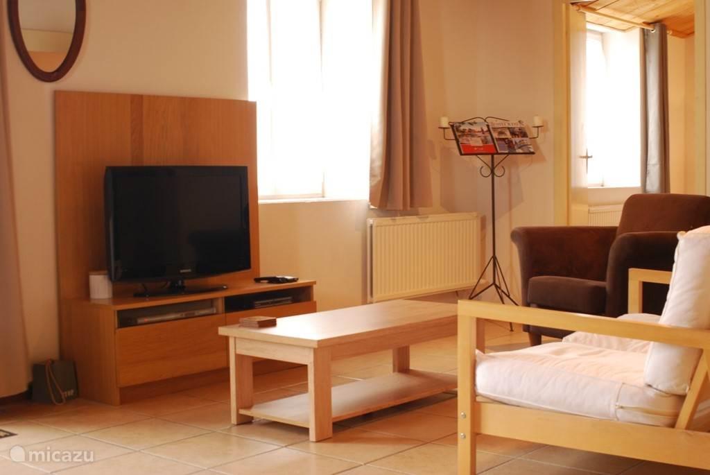Ruime L-vormige huiskamer