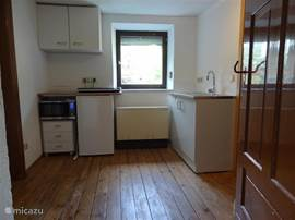 The kitchen on the first floor has a kitchen, microwave ceramic hob and fridge freezer.