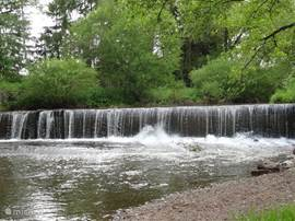 This waterfall in the river is not somewhere in a distant place, but simply dangle in the Alf 400 meters from your house.