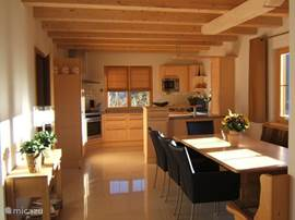 The dining room and kitchen.