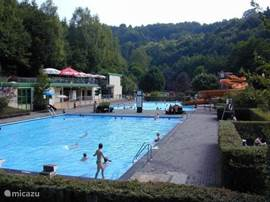 Freibad Kyllburg, werwarmd large outdoor pool with slide, diving board and children's pool, surrounded by forest, 1 km away from the house.
