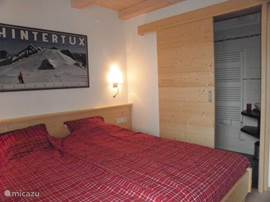 Beautiful bedroom apartment Kristall with ensuite bathroom with shower and sink.