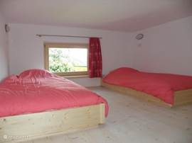 This is the hoss. The space above one of the bedrooms. Suitable for children up to 12 years due to a height of 1.50m.